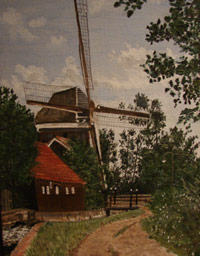 Windmill in the Netherlands (brown house with red roof attached to left side of the windmill with water below; dirt road on right)