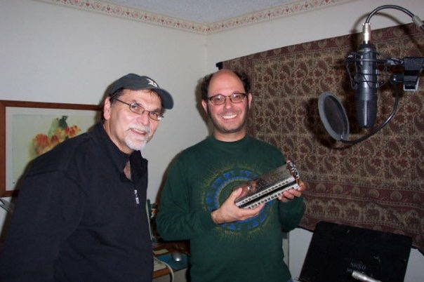 Picture of DC Bloom and Michael Rubin inside ByrdHouseStudio holding a bass harmonica
